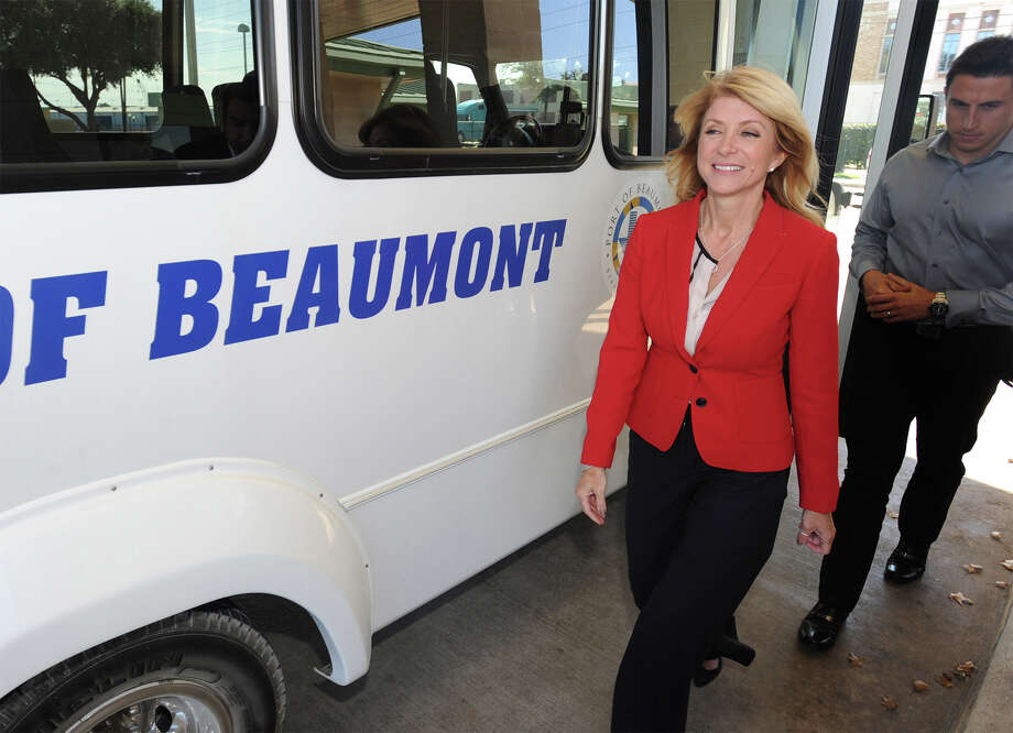 State Senator Wendy Davis exits a bus tour at the Port of Beaumont on Tuesday. Davis, who is running for governor, toured the port with later plans to raise money before leaving the area. Davis is recognized for her recent 11-hour filibuster against a strict abortion bill. Photo taken Tuesday, November 19, 2013 Guiseppe Barranco/@spotnewsshooter Photo: Guiseppe Barranco, Photo Editor