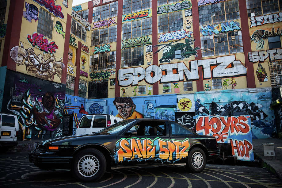 A graffiti painted car is parked in front of the 5 Pointz Building, a landmark in the New York graffiti scene that has attracted artists from around the globe, on October 28, 2013 in the Long Island City neighborhood of the Queens borough of New York City. Photo: Andrew Burton, Getty Images / 2013 Getty Images