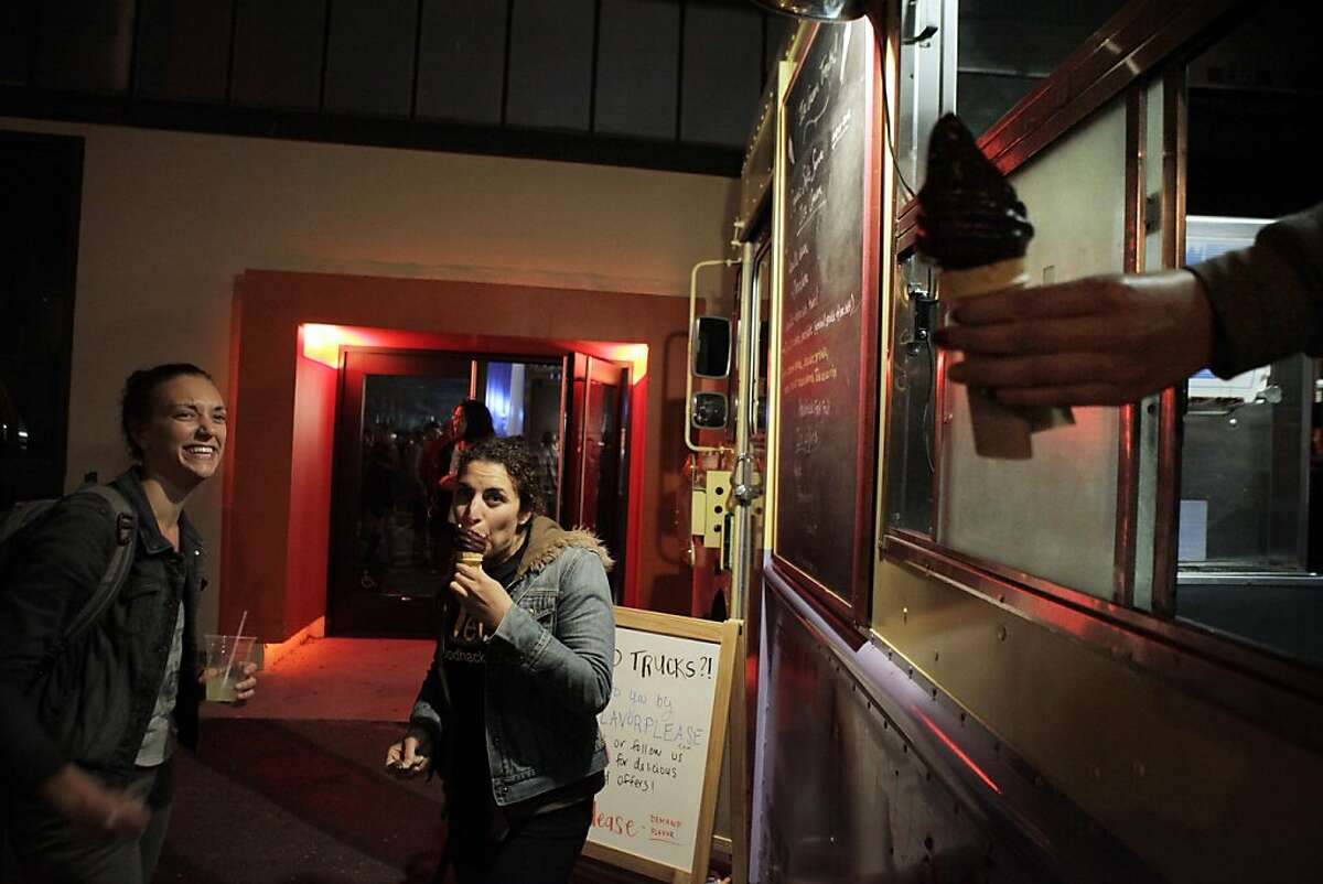 Sarah Smith and Ilana Lipsett enjoy a chocolate dipped ice cream cone at the Food Hackathon after party at Tcho on Sunday. The world's largest food hackathon, �