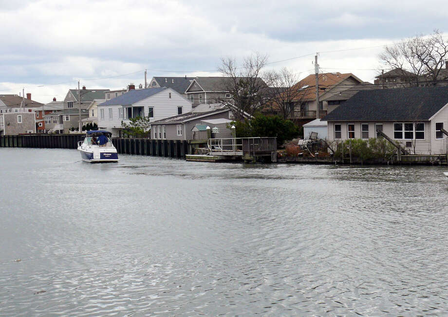 The town has received permission to dredge Pine Creek to clear out sand deposited there during Superstorm Sandy. Photo: Genevieve Reilly / Fairfield Citizen