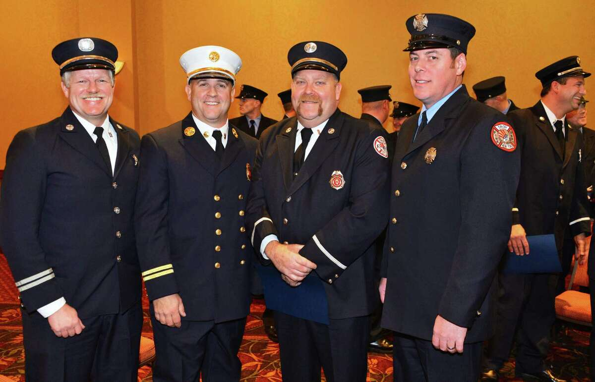 Troy firefighters recognized for their outstanding rescue at an apartment complex in Watervliet last September, from left, Capt. Tom Miter, Battalion Chief David Paul, Capt. Matthew Cipriono and firefighter Joseph Coonan during a ceremony Tuesday Nov. 19, 2013, in Troy, NY. (John Carl D'Annibale / Times Union)