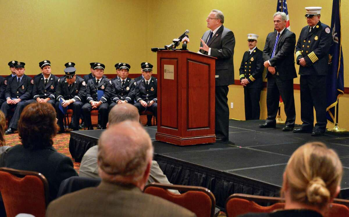 Troy Mayor Lou Rosamilia presides over ceremonies to promote fire departmentt officers and award medals of valor to firefighters recognized for their outstanding rescue at an apartment complex in Watervliet last September Tuesday Nov. 19, 2013, in Troy, NY. (John Carl D'Annibale / Times Union)