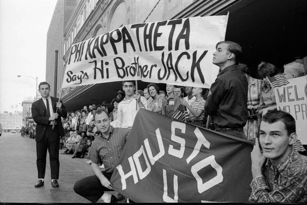 On November 21, 1963 -- the day before John F. Kennedy was assassinated -- Truxillo was among the University of Houston Phi Kappa Theta fraternity members who stood outside Houston's Rice Hotel, waiting to greet their fraternal alumni brother, the president. Left to right, holding the banner: Norman Ehrentraut, Jay Kirk and Bart Truxillo. Left to right, kneeling with the UH flag: Gene Deluke and Jim Kadlechk were outside the Rice Hotel to greet their fraternal alumni brother, Pres. John F. Kennedy.