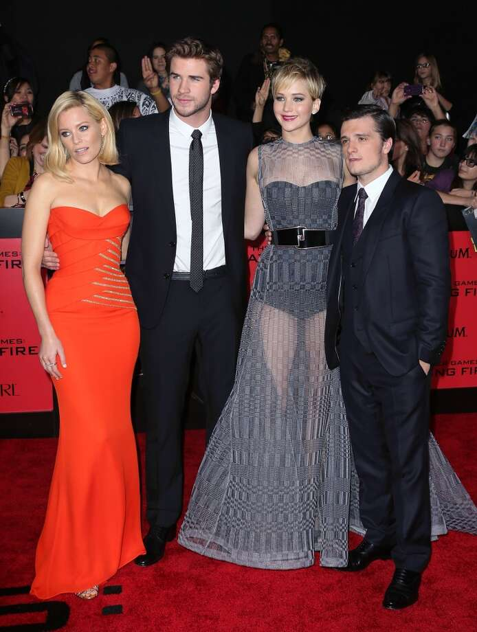 "(L-R) Actors Elizabeth Banks, Liam Hemsworth, Jennifer Lawrence and Josh Hutcherson attend the premiere of Lionsgate's ""The Hunger Games: Catching Fire"" at Nokia Theatre L.A. Live on November 18, 2013 in Los Angeles, California. Photo: David Livingston, Getty Images"