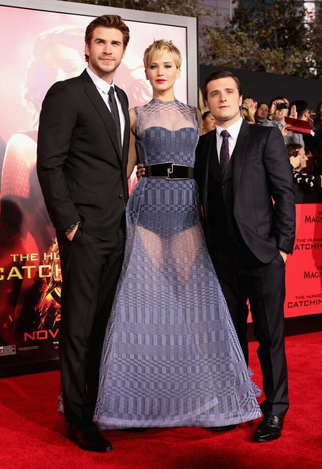 "(L-R) Actors Liam Hemsworth, Jennifer Lawrence and Josh Hutcherson attend premiere of Lionsgate's ""The Hunger Games: Catching Fire"" - Red Carpet at Nokia Theatre L.A. Live on November 18, 2013 in Los Angeles, California. Photo: Christopher Polk, Getty Images"