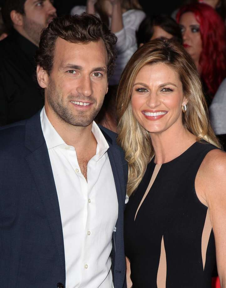 "NHL Player Jarret Stoll (L) and sportscaster Erin Andrews attend the premiere of Lionsgate's ""The Hunger Games: Catching Fire"" at Nokia Theatre L.A. Live on November 18, 2013 in Los Angeles, California. Photo: David Livingston, Getty Images"