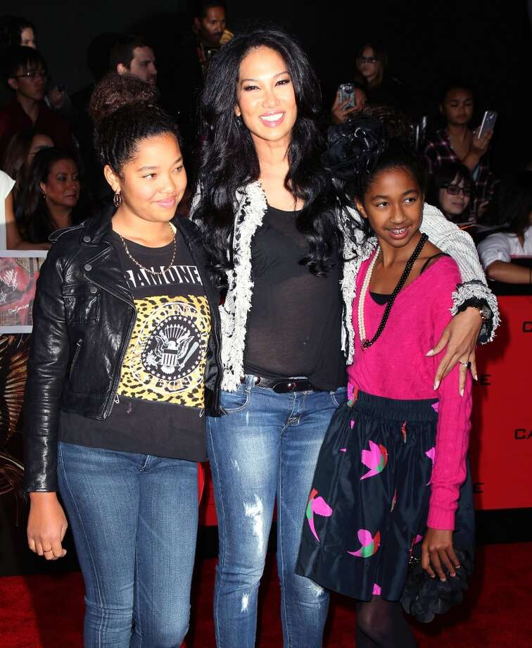 "Kimora Lee Simmons (C) and daughters attend the premiere of Lionsgate's ""The Hunger Games: Catching Fire"" at Nokia Theatre L.A. Live on November 18, 2013 in Los Angeles, California. Photo: David Livingston, Getty Images"