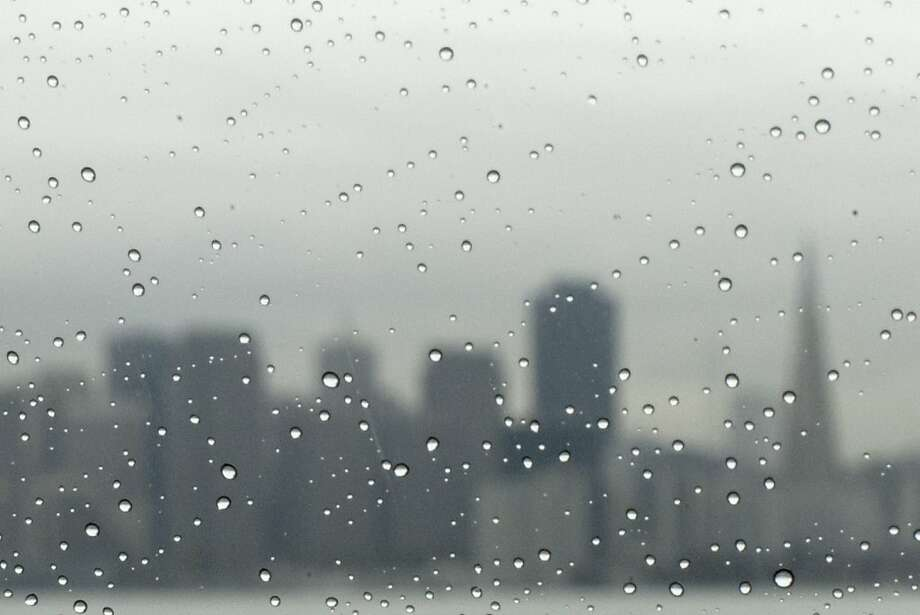 With the San Francisco skyline in the background, rain drops collects on a car window during a light rainfall Tuesday, Nov. 19, 2013. Photo: Douglas Zimmerman, SF Gate