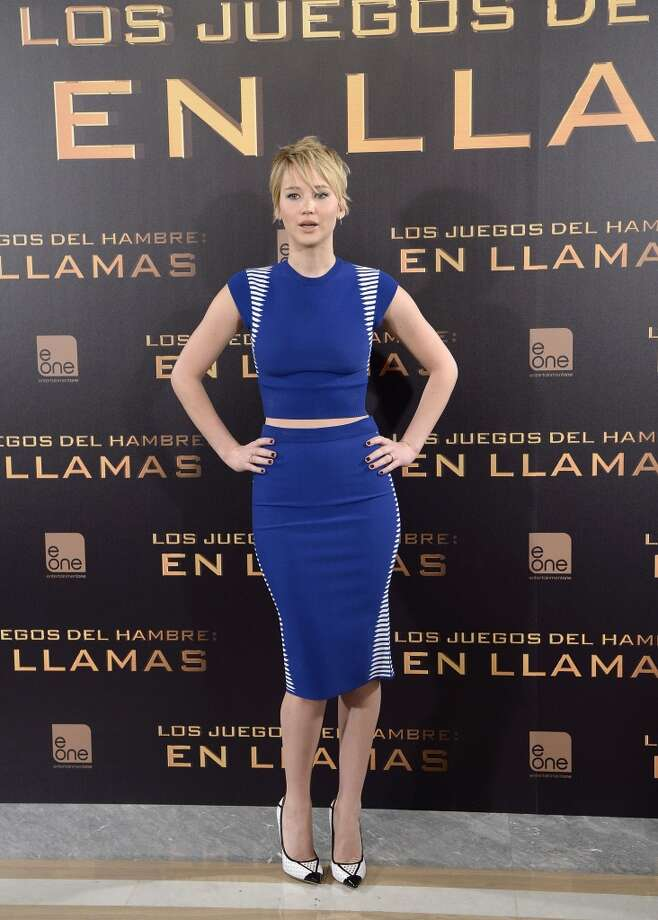 Jennifer Lawrence bares just a hint of belly at the Madrid photocall. Photo: Fotonoticias, FilmMagic
