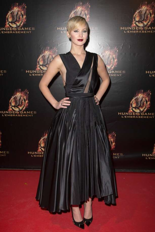 Jennifer Lawrence in a stunning black dress with just a hint of sheer in the bust. Photo: Marc Piasecki, WireImage