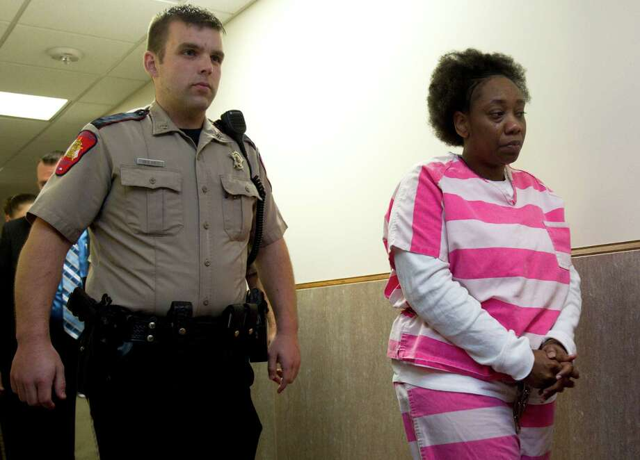 Verna McClain is led into the courtroom before entering a guilty plea for the April 2012 slaying of 28-year-old Kala Golden-Schuchardt Tuesday, Nov. 19, 2013, in Conroe. McClain was accused of fatally shooting the new mother outside a pediatric clinic in Spring and snatching her 3-day-old son, Keegan. He later was found safe with McClain's sister. Photo: Brett Coomer, Houston Chronicle / © 2013 Houston Chronicle