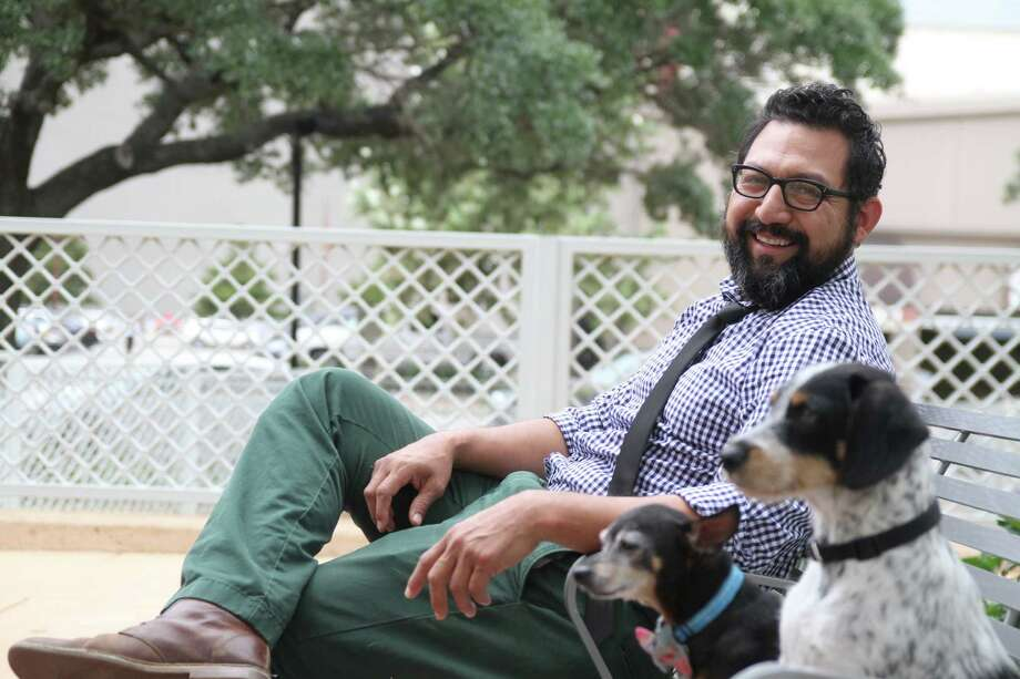 Hector Garcia, who designed a special doghouse for the Barkitecture charity event to aid orphaned pupplies , enjoys spending time with his own dogs. Photo: Pin Lim, Freelance / Copyright Pin Lim.