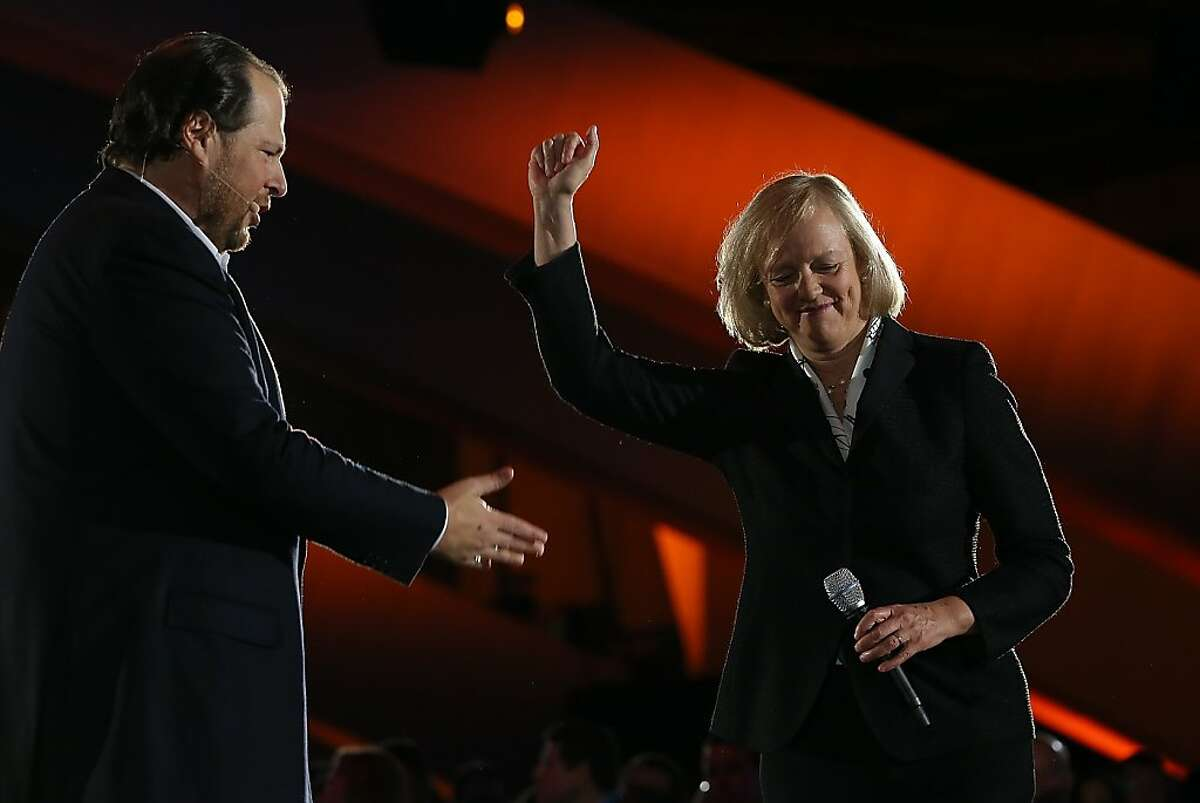 SAN FRANCISCO, CA - NOVEMBER 19: Salesforce chairman and CEO Marc Benioff (L) speaks with Hewlett Packard CEO Meg Whitman during a keynote address at the 2013 Dreamforce conference on November 19, 2013 in San Francisco, California. The annual Dreamforce conference runs through November 21. (Photo by Justin Sullivan/Getty Images)