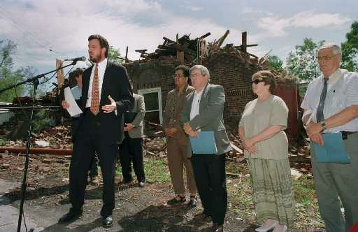 Mechanicville Mayor Thomas Higgins is shown at right in a 1998 archive photo. New York City Mayor-elect Bill de Blasio, then with the regional HUD office, and Saratoga County officials, address the media in Mechanicville in the aftermath of a May 31, 1998, tornado. (Times Union archives)