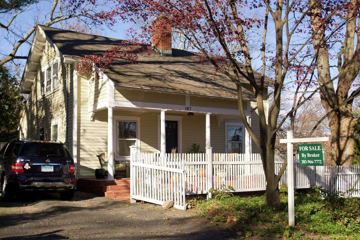 A home that was previously for sale in New Canaan. A six-month trial banning real estate signs in front of houses for sale will begin July 1 and conclude Jan. 1, 2019.