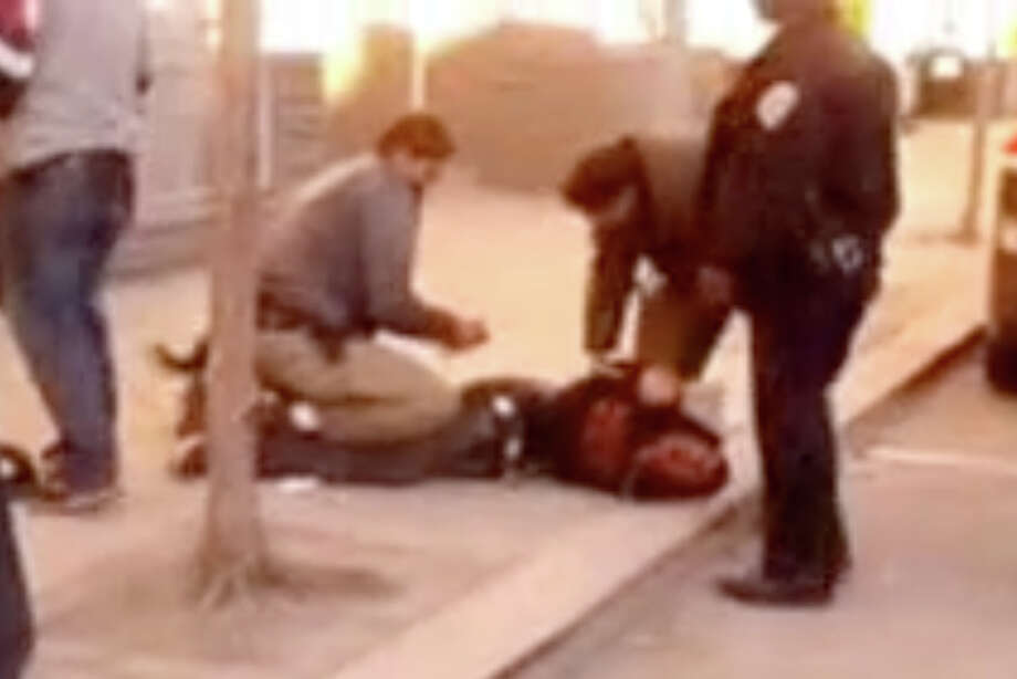 The arrest of 20-year-old D'Paris Williams, who was targeted by officers Friday for riding his bike on a sidewalk. A YouTube video shows Williams being held on the ground by plainclothes officers, and taken away injured and moaning. Photo: YouTube