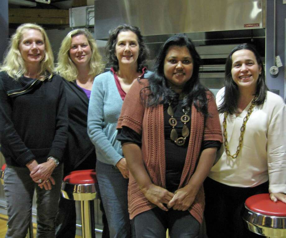 Outback Teen Center board members gather after completing the community annual appeal mailing. From left, Eileen Boyd, Lisa D'Virgilio, June Bird, Sangeeta Appel and Claudia Pagazani. Photo: Contributed Photo / New Canaan News