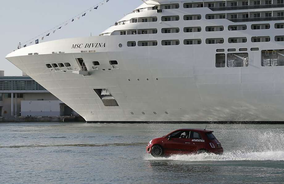 Hydroplaning vehicle:A Fiat 500 speeds past the MSC Divina cruise ship, which was making its North American debut at the Port of Miami. The Fiat is, of course, a watercraft made to resemble the car - it can't travel on land. Photo: Lynne Sladky, Associated Press