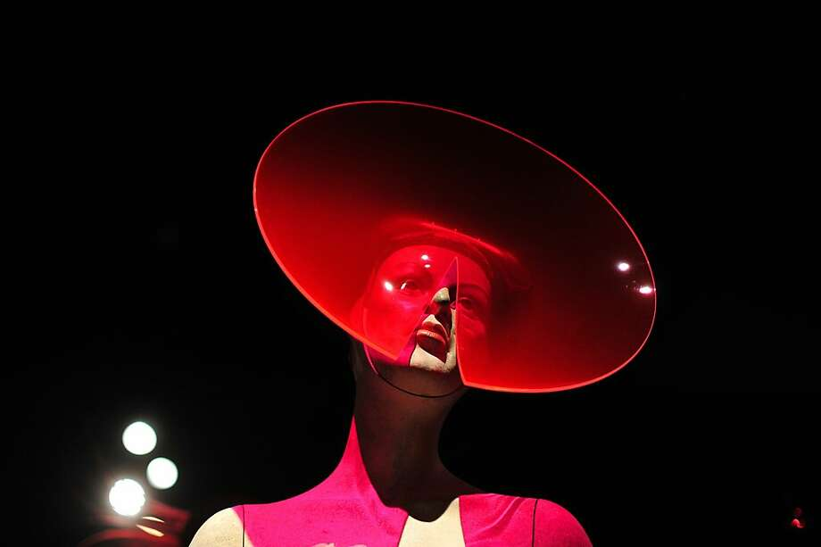 "Tray chic: British designer Philip Treacy designed this dishy hat for the ""Isabella Blow: Fashion Galore!"" exhibition at Somerset House in London. It has a slit detail that allows the wearer to talk and breathe. Photo: Carl Court, AFP/Getty Images"