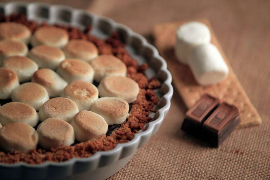 S'mores Pie's golden-browned marshmallows float on a sea of chocolate filling in a graham cracker crust - perfection. Photo: Mayra Beltran, Staff / © 2013 Houston Chronicle