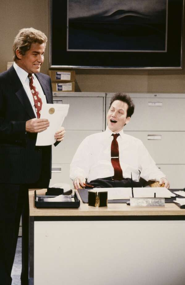 "Rob Schneider, right, in a 1991 SNL skit as the ""Richmeister"" wtih Phil Hartman, left. Photo: NBC, NBC Via Getty Images"