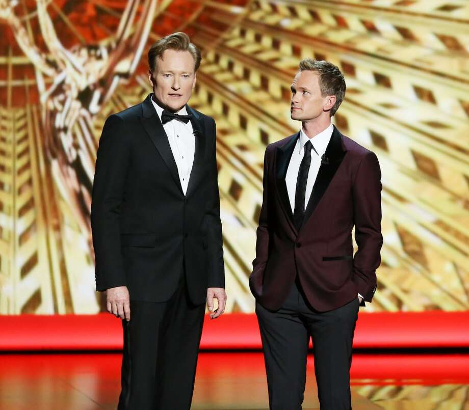 Conan O'Brien (L) turned 50 on April 18. He's pictured with Neil Patrick Harris at the Primetime Emmy Awards on September 22, 2013. Photo: Michael Tran, FilmMagic