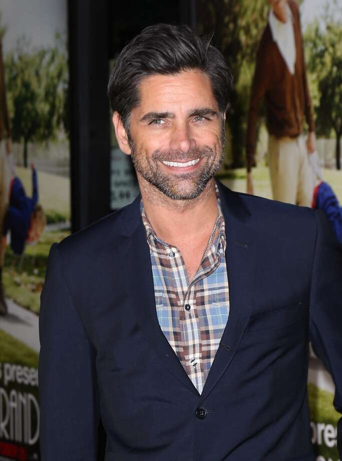 "John Stamos turned 50 on Aug. 19. He's pictured at the premiere ""Jackass Presents: Bad Grandpa""  on October 23, 2013. Photo: David Livingston, Getty Images"