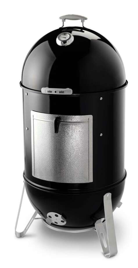 The Weber 22.5-inch Smokey Mountain Cooker Smoker has 50 percent more cooking area than Weber's 18-inch model. It is equipped with a lid-mounted temperature gauge and a no-rust aluminum door with a new spring-loaded latch for easy access to the charcoal/wood chunks or chips chamber and the larger porcelain-enameled water pan. Other features include two plated steel 22.5   diameter cooking grates which provides ample room for smoking a turkey and a ham at the same time, a porcelain-enameled bowl and lid and water pan, and four no-rust aluminum vents. A premium cover ships with the smoker. Photo: 2012 Weber-Stephen Products LLC / Weber owns 100% of the rights