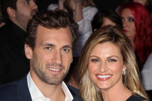 "NHL Player Jarret Stoll (L) and sportscaster Erin Andrews attend the premiere of Lionsgate's ""The Hunger Games: Catching Fire"" at Nokia Theatre L.A. Live on November 18, 2013 in Los Angeles, California."