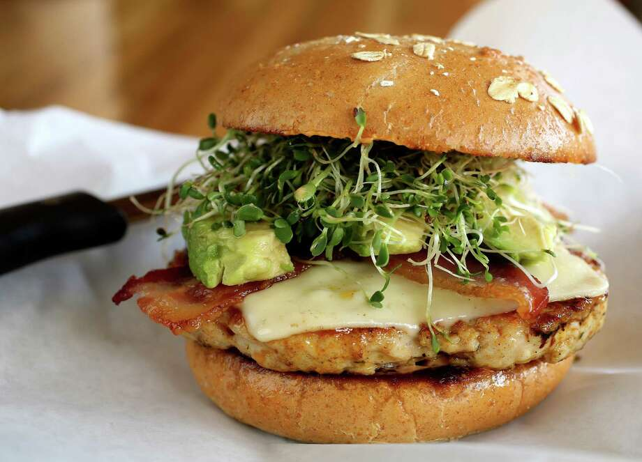 The Jive Turkey (100% turkey breast, ground and pesto seasoned with bacon, swiss, sprouts, avocado and chipotle aioli on a whole wheat bun) at the Grub Burger Bar, Wednesday, Nov. 6, 2013, in Houston. ( Karen Warren / Houston Chronicle ) Photo: Karen Warren, Staff / © 2013 Houston Chronicle
