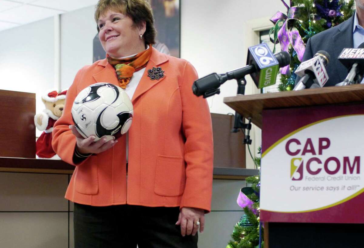 Paula Stopera, president and CEO of Cap Com, takes part in an event held at the Cap Com Federal Credit Union to kick off the PAL holiday toy drive on Tuesday, Nov. 19, 2013 in Albany, NY. Each year Albany PAL and organizations working with them provide more than 2,500 toys to needy children during the holidays. (Paul Buckowski / Times Union)