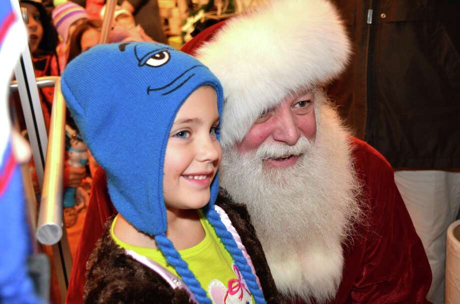 Santa draws a crowd on Elm Street Friday night during last year's Holiday Stroll. This year's event is Dec. 6 and 7. Photo: Jeanna Petersen Shepard / New Canaan News