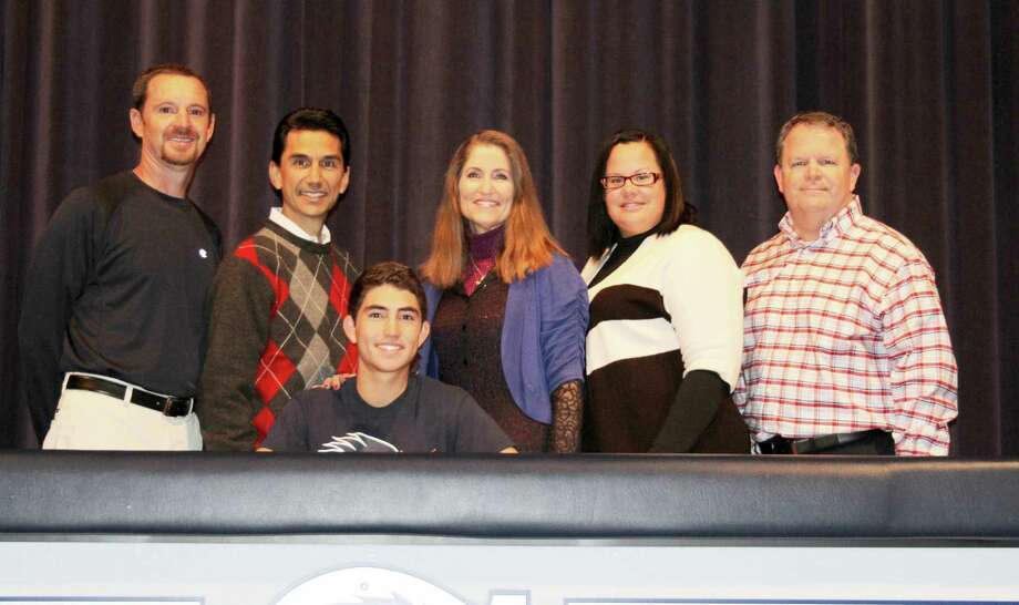Boerne Champion senior Zander Lozano, seated, signs to play college golf at UTSA. Others are, from left, head trainer Terry Gault; Zander's parents, Omar and Cheryl Lozano; golf coach Tabitha Oates; and BISD Athletic Director Stan Leech. Photo: Russell Hawkins / Courtesy Photo
