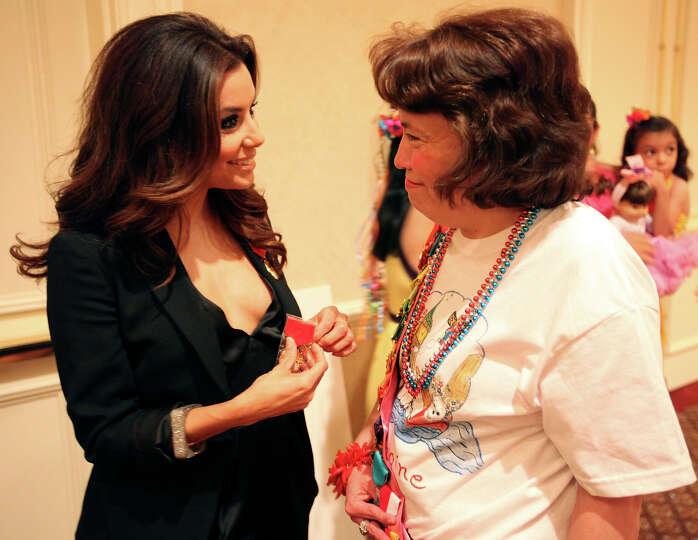 FOR METRO - Eva Longoria (left) talks with her sister Liza Longoria after Eva received a check for f