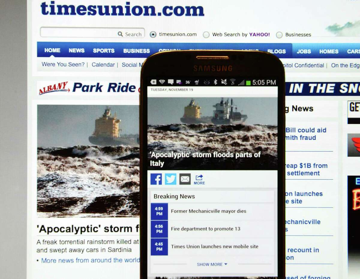 Comparison of timesunion.com's new mobile site and the legacy website are pictured Tuesday, Nov. 19, 2013, in Colonie, N.Y. (Will Waldron/Times Union)