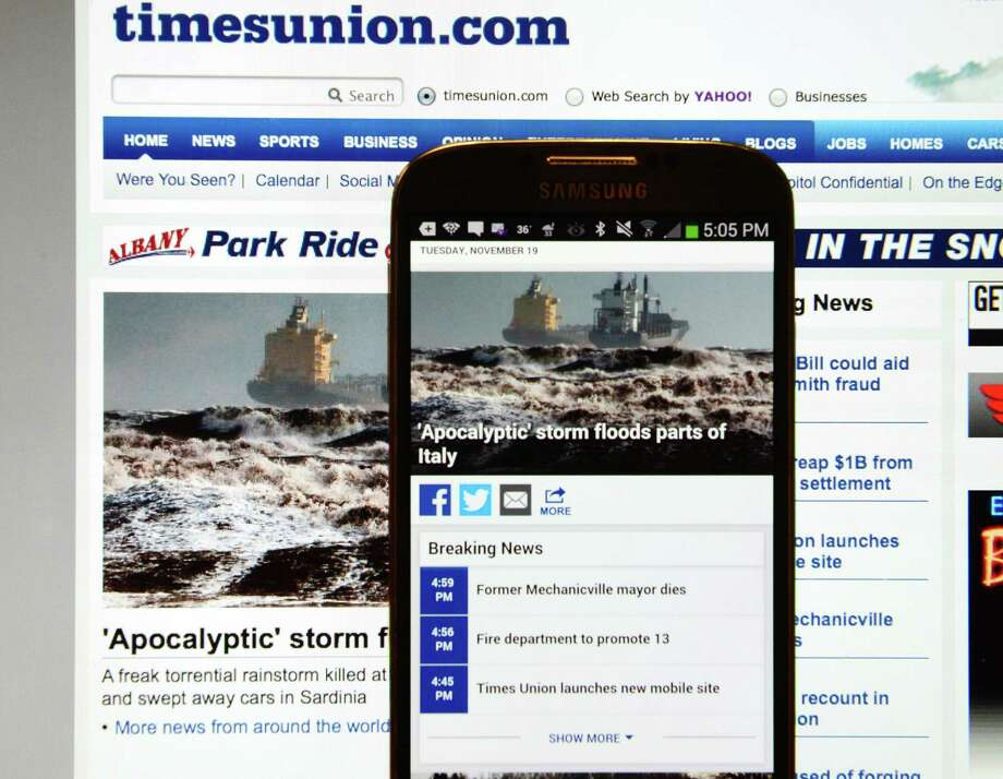 Comparison of timesunion.com's new mobile site and the legacy website are pictured Tuesday, Nov. 19, 2013, in Colonie, N.Y. (Will Waldron/Times Union) Photo: WW
