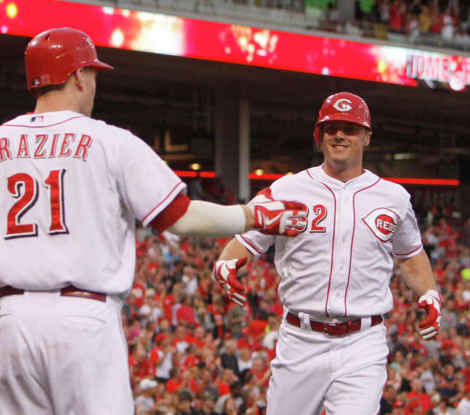 Cincinnati Reds' Jay Bruce (32) is congratulated by teammate Todd Frazier (21) after hitting a solo home run off Houston Astros starting pitcher Bud Norris in the second inning during a baseball game on Saturday, Sept. 8, 2012, in Cincinnati. (AP Photo/David Kohl) Photo: David Kohl, FRE / FR51830 AP
