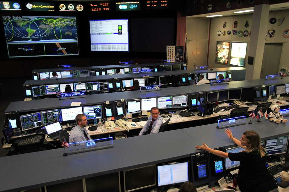 Flight Director Ed Van Cise and Capsule Communicator and  Canadian Space Agency (CSA) Astronaut David Saint-Jacques work with flight crew to support the International Space Station from Mission Control at Johnson Space Center on Tuesday, Nov. 19, 2013, in Houston. The International Space Station has been in operation for 15 years. Photo: Mayra Beltran, Houston Chronicle / © 2013 Houston Chronicle