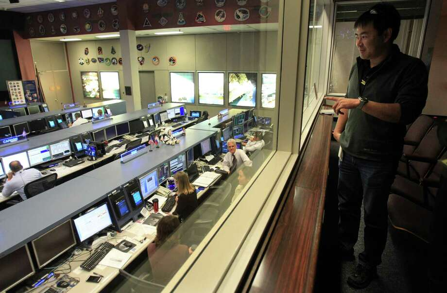 JAXA Astronaut Akihiko Hoshide, who has been aboard the International Space Station, visits Mission Control at Johnson Space Center on Tuesday, Nov. 19, 2013, in Houston. The International Space Station has been in operation for 15 years. Photo: Mayra Beltran, Houston Chronicle / © 2013 Houston Chronicle