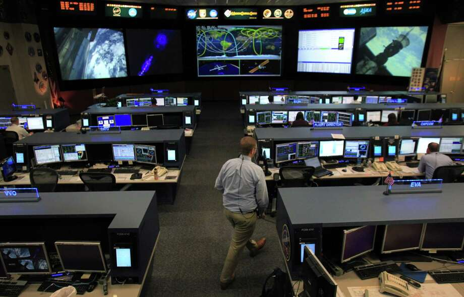 Flight path of International Space Station (ISS) can be seen on the screen as Flight Director Ed Van Cise supports ISS from Mission Control at Johnson Space Center on Tuesday, Nov. 19, 2013, in Houston. The International Space Station has been in operation for 15 years. Photo: Mayra Beltran, Houston Chronicle / © 2013 Houston Chronicle