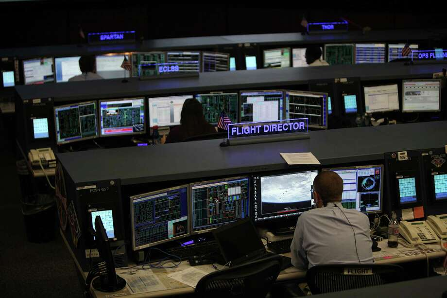 Flight staff support the International Space Station from Mission Control at Johnson Space Center on Tuesday, Nov. 19, 2013, in Houston. The International Space Station has been in operation for 15 years. Photo: Mayra Beltran, Houston Chronicle / © 2013 Houston Chronicle