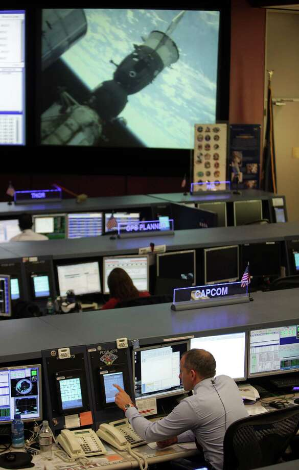 A live view of the International Space Station fills the big screen on Tuesday at the Johnson Space Center's Mission Control, with Capsule Communicator and Canadian Space Agency astronaut David Saint-Jacques monitoring its systems. Photo: Mayra Beltran, Staff / © 2013 Houston Chronicle
