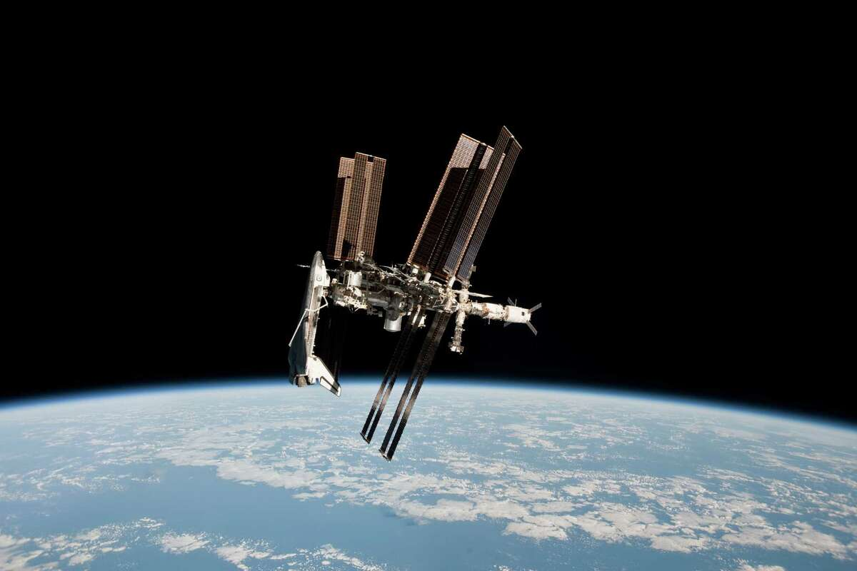 This image of the International Space Station and the docked shuttle Endeavour, orbiting at an altitude of approximately 220 miles, was taken by Expedition 27 crew member Paolo Nespoli from the Russian Soyuz TMA-20 on May 23, 2011.
