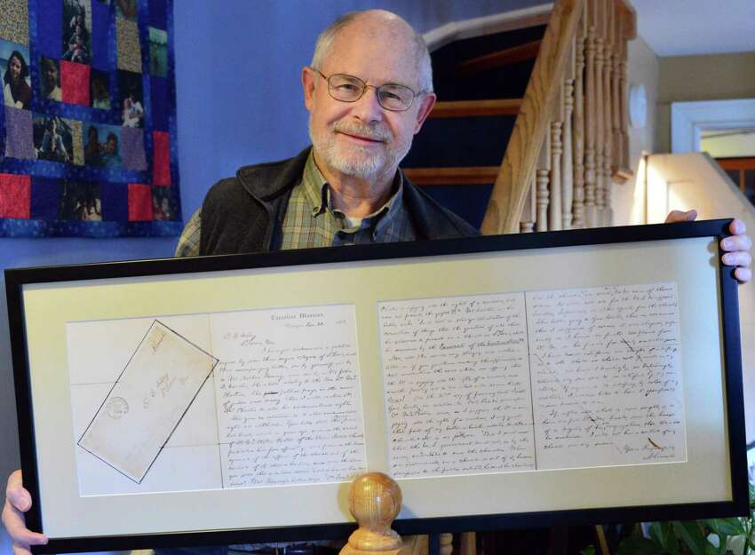 Tom McPheeters holds a framed facsimile of the letter President Abraham Lincoln sent to the Mayor of St. Louis regarding his great-great-grandfather, the Rev. Samuel B. McPheeters Tuesday, Nov. 19, 2013, in Albany, N.Y. (John Carl D'Annibale / Times Union)