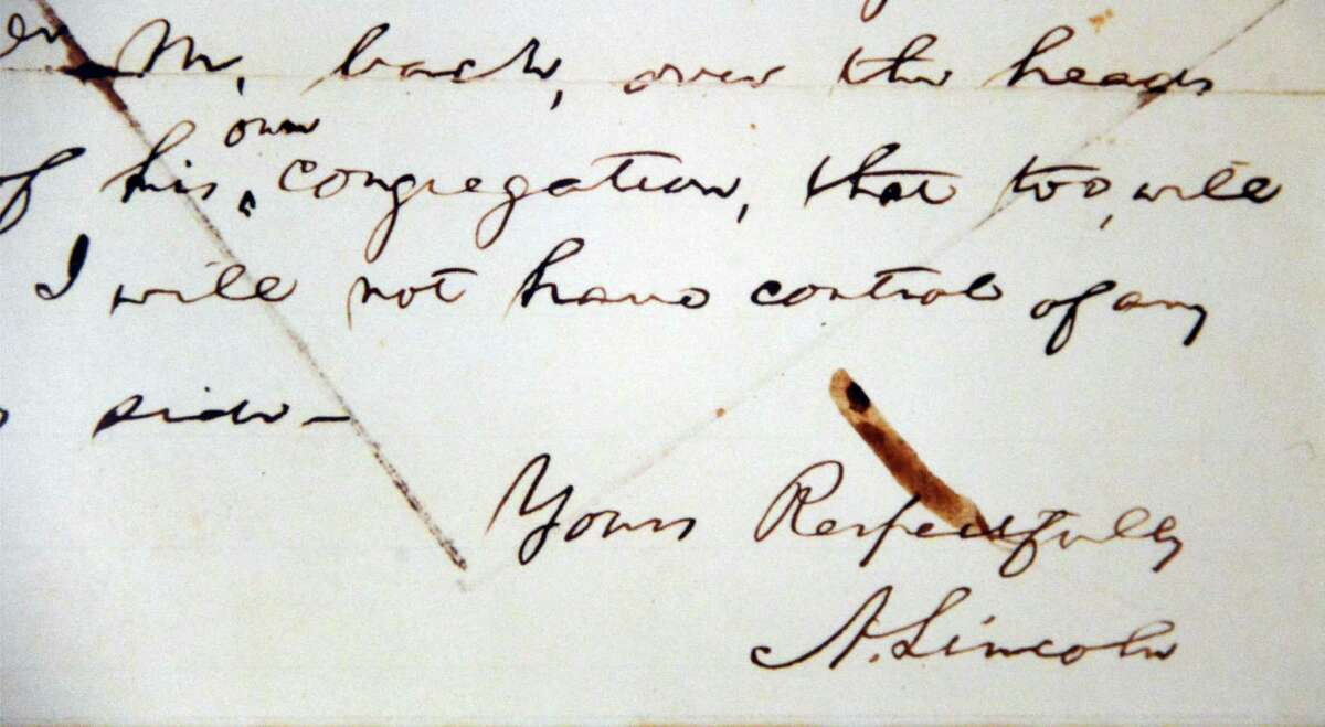 Abraham Lincoln's signature is featured on Tom McPheeters' framed facsimile of the letter President Lincoln sent to the Mayor of St. Louis regarding McPheeters' great-great-grandfather, the Rev. Samuel B. McPheeters Tuesday, Nov. 19, 2013, in Albany, N.Y. (John Carl D'Annibale / Times Union)