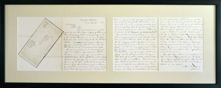 Tom McPheeters' framed facsimile of the letter President Abraham Lincoln sent to the Mayor of St. Louis regarding his great-great-grandfather, the Rev. Samuel B. McPheeters Tuesday, Nov. 19, 2013, in Albany, NY. (John Carl D'Annibale / Times Union)