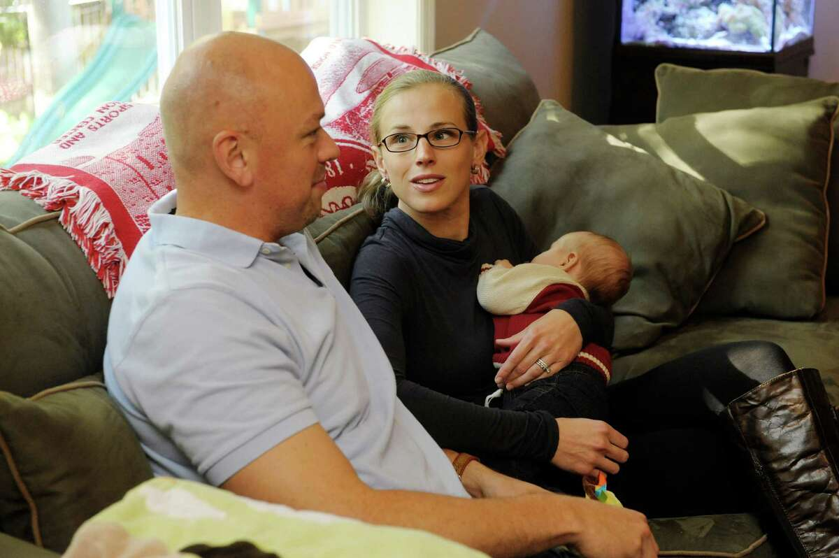 Husband and wife, Jonathan Jones, Jr. and katie Jones talk about their decision to have a home birth for their son, Jonathan III, 3 months, who Katie is holding. Photograph taken at their home on Sunday, Oct. 13, 2013 in Clifton Park, NY. (Paul Buckowski / Times Union)