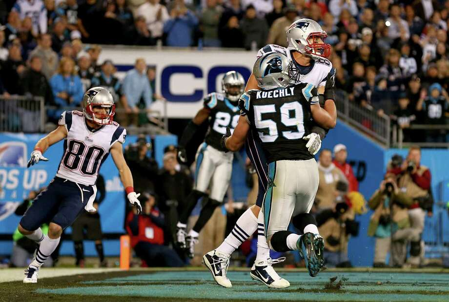 CHARLOTTE, NC - NOVEMBER 18:   Rob Gronkowski #87 of the New England Patriots and Luke Kuechly #59 of the Carolina Panthers fight for the ball in the end zone on the last play of the game at Bank of America Stadium on November 18, 2013 in Charlotte, North Carolina.  (Photo by Streeter Lecka/Getty Images) ***BESTPIX*** ORG XMIT: 184892950 Photo: Streeter Lecka / 2013 Getty Images