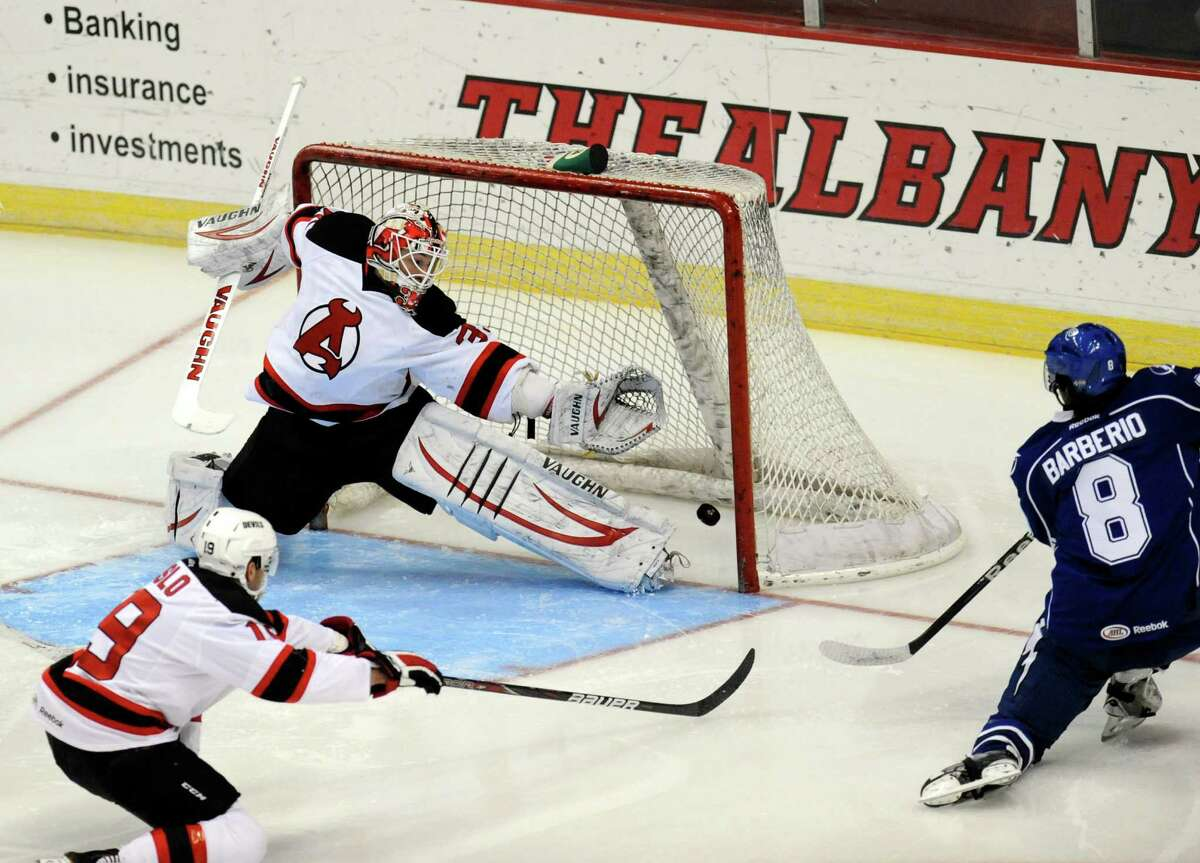 Syracuse Crunch's Mark Barberio (8) scores on Albany Devils' Goalie Keith Kinkaid (35) during the first period of their AHL hockey game, Wednesday, Feb. 13, 2013, in Albany, N.Y. (Hans Pennink / Special to the Times Union) Pro Sports