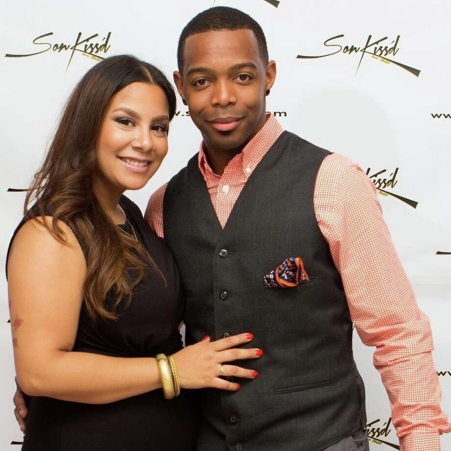 SonKiss'd's artistic director Christopher (YungChris) Thomas and wife pose on the SonKiss'd Theater's red carpet before a production. Photo: SonKiss'd Dance Theater